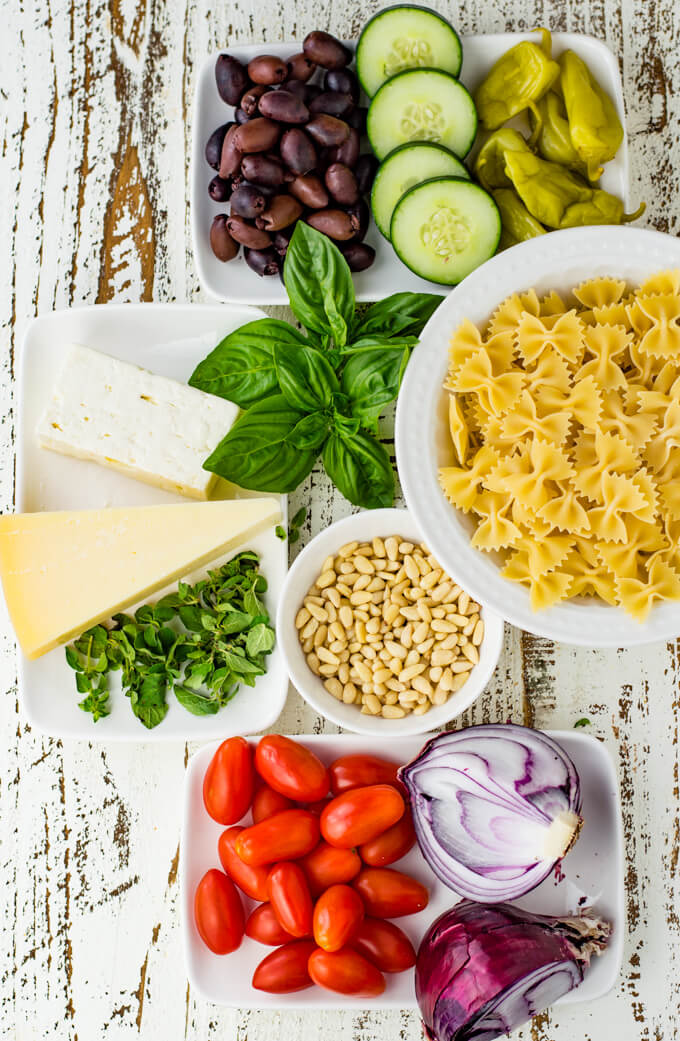 Ingredients that go into a mediterranean pasta salad.