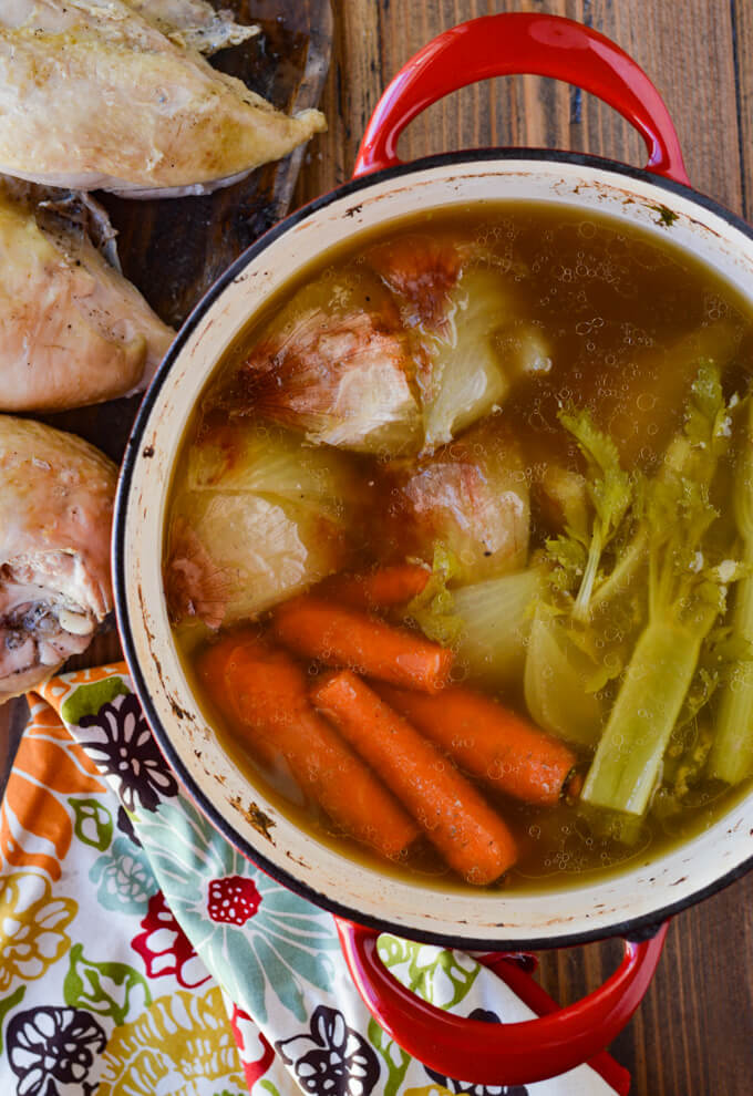 Chicken, carrots, celery with onions cooked in a Dutch oven with