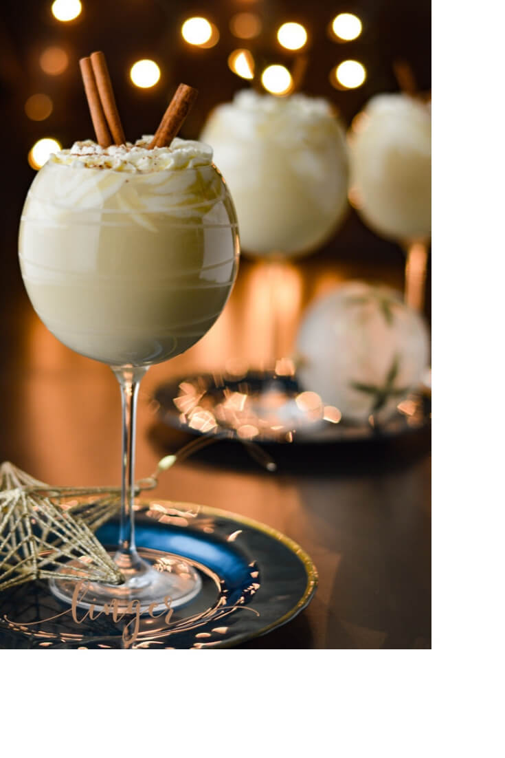 The perfect Holiday cocktail for Thanksgiving and Christmas. This spiked bourbon eggnog recipe is great for making ahead and giving as a gift or sipping with friends. It's aged and loaded with loaded with alcohol for a boozy drink. #eggnog #homemadeeggnog #Thanksgivingcocktail #Christmascocktail #spikedholidaycocktail #bourbonrecipes