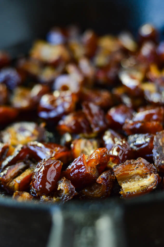 Chopped Medjool dates in a cast iron skillet.