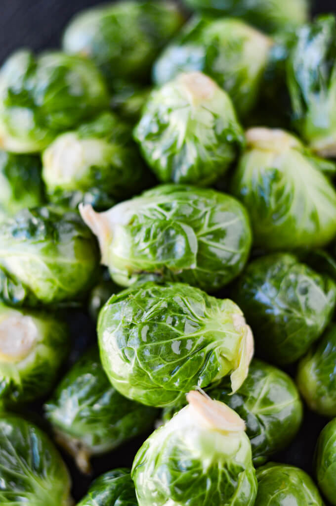 A bunch of raw brussel sprouts.