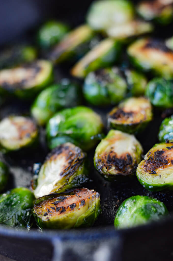 Charred Brussel Sprouts in a coast iron pan.