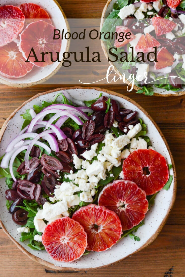 A Healthy Blood Orange Arugula Salad with Feta and Kalamata Olives - a simple salad with a stunning presentation. Loads of color and texture. The citrus vinaigrette adds to the complexity of flavors. This is a super easy recipe that can be thrown together in less than 10 minutes. #bloodoranges  #arugula #salads