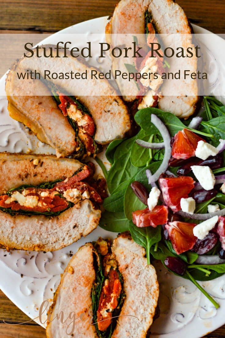 This healthy Pork Roast Stuffed with Roasted Red Peppers, Feta and Spinach is loaded with layers of flavor. Mediterranean rub adds intensity to the roast. This pork recipe is roasted in the oven and is perfect for the Holidays and Christmas Dinner.  #porkroast #stuffedporkroast #stuffedroast  #dinner #pork #healthy #Christmasdinner