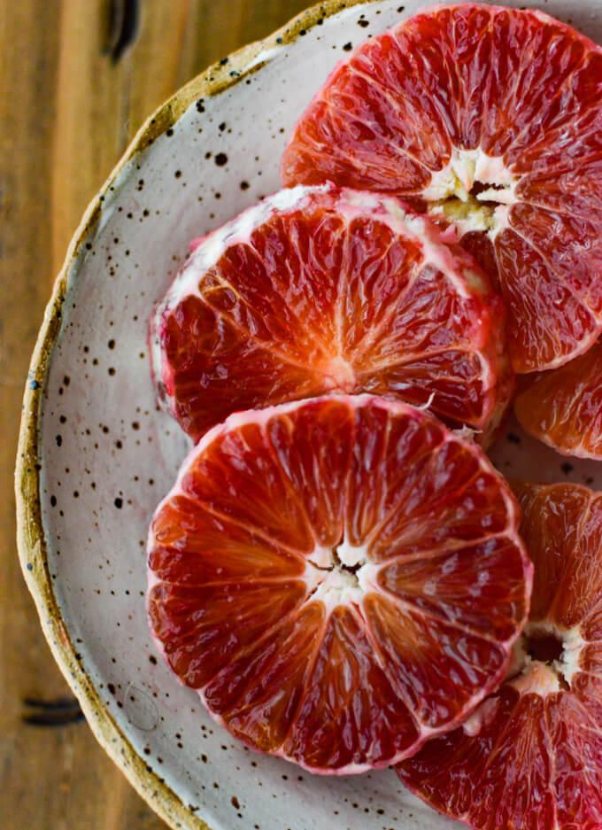 A bowl of sliced blood oranges.