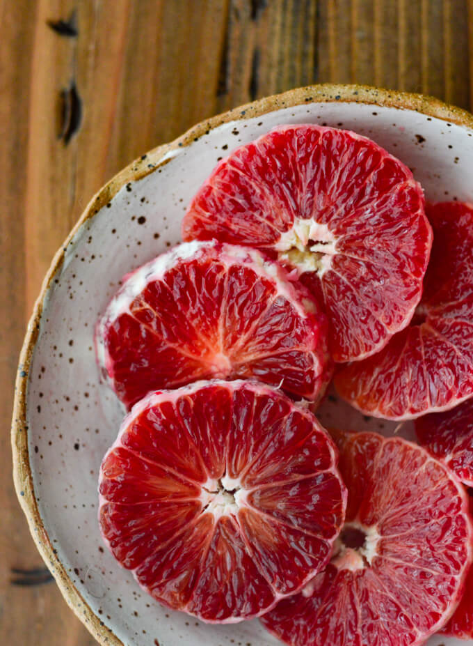 A bowl of sliced blood oranges.