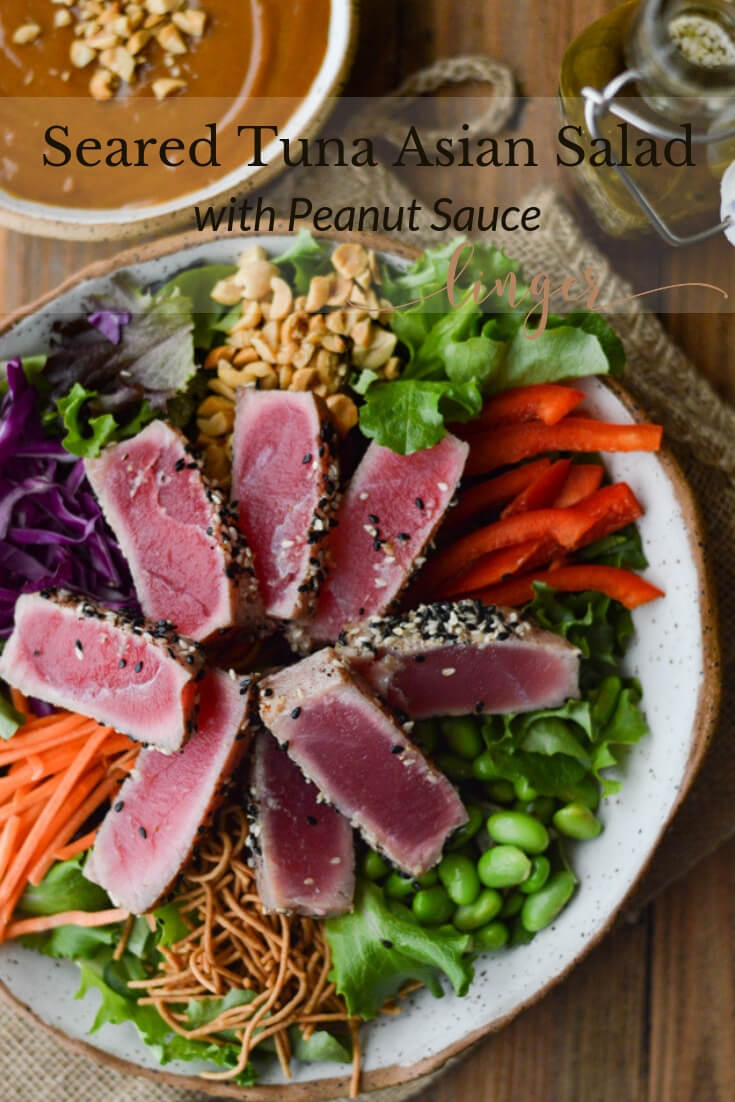 Crunchy Asian Seared Tuna Salad with Peanut Sauce is brimming with color, texture, and flavor. The tuna is like butter that melts in your mouth. Asian Dressing and Peanut sauce top this salad with yumminess. #searedtuna #asiansalad #salads