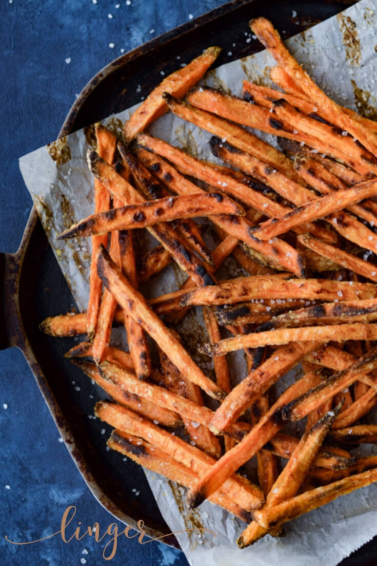 These Crispy Baked Sweet Potato Fries are scrumptiously healthy. Sprinkle with salt right out of the oven then indulge. A delicious baked snack with 3 different dipping sauces. #sweetpotatoes #sweetpotatofries #dippingsauces #sweetpotatorecipes #dippingsauces #dippingsaucerecipes #aioli