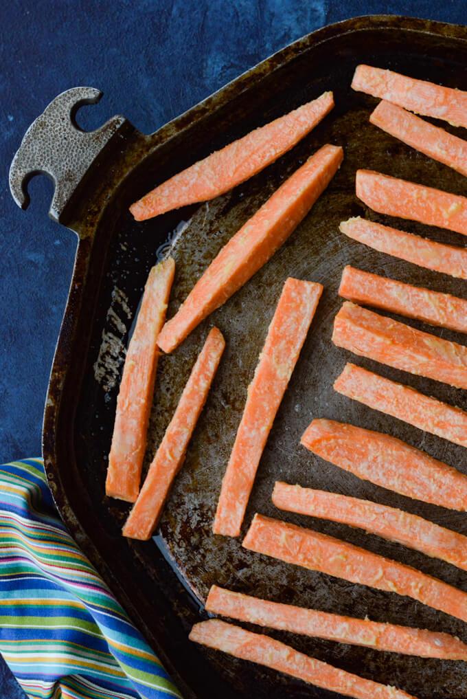 A pan of raw sweet potatoes fries.