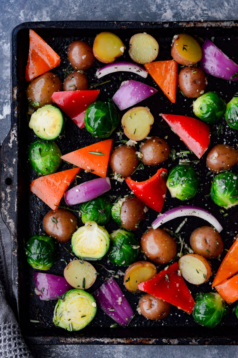 Roasted Veggies with Garlic and Herbs on a cookie sheet, raw