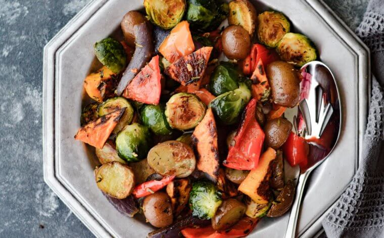 Perfectly Roasted Veggies with Garlic and Herbs in a silver dish