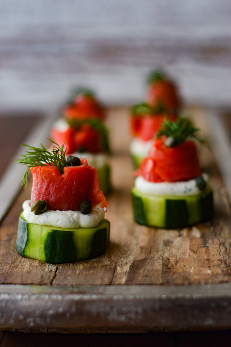 Smoked Salmon and Cream Cheese Timbales with Cucumbers on a wooden tray