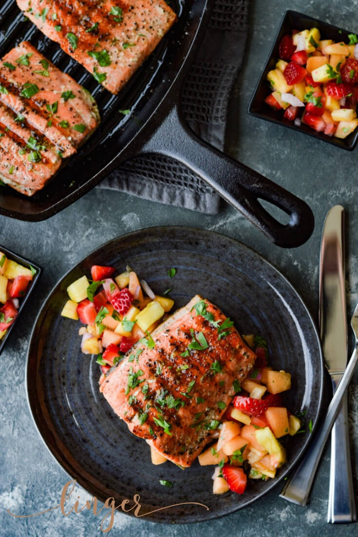 Pan Seared Sockeye Salmon with Fruit Salsa dish is healthy, quick and easy. The salmon is marinated in a lemon-lime garlic sauce, pan seared in a cast iron pan and rests on a colorful bed of a fresh fruit salsa. #sockeyesalmon, #wildcaughtsalmon, #fruitsalsa, #seafood, #easyrecipes, #healthyrecipes, #castironskillet