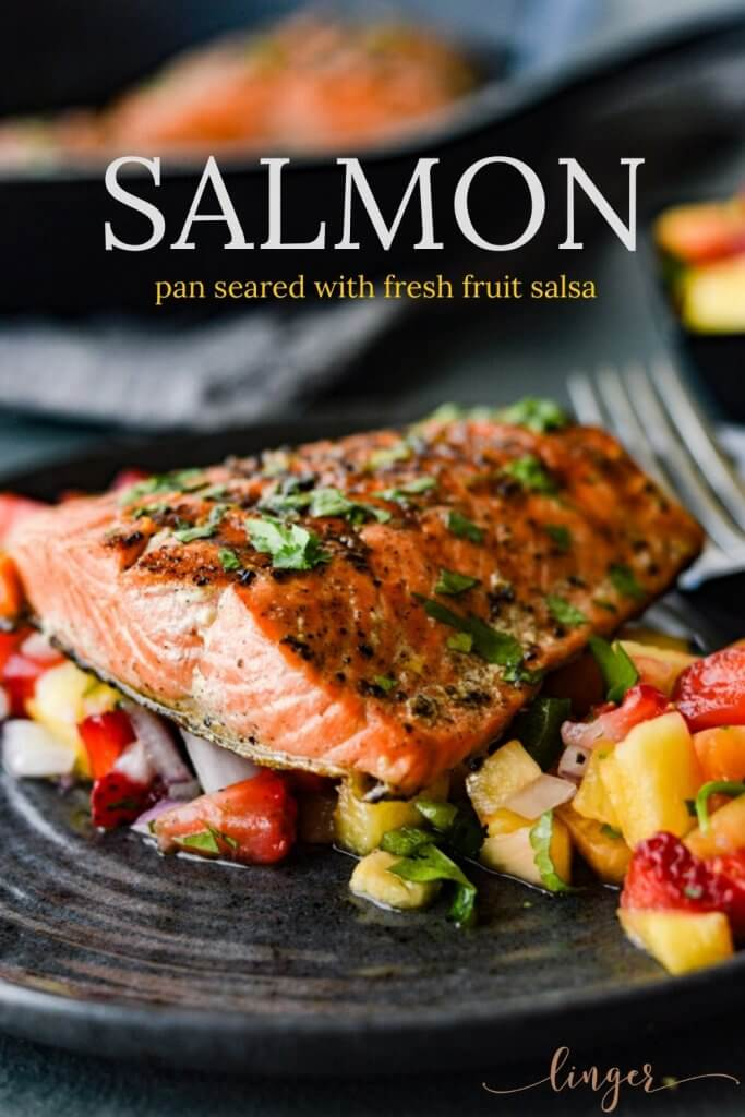 A pan seared salmon fillet on a bed of fruit salsa.