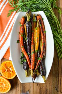 Roasted Candied Rainbow Carrots with Orange-Maple Syrup in a serving dish