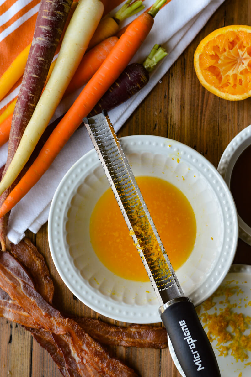 Roasted Candied Carrots with Orange Maple Syrup - raw carrots with orange juice, bacon and maple syrup