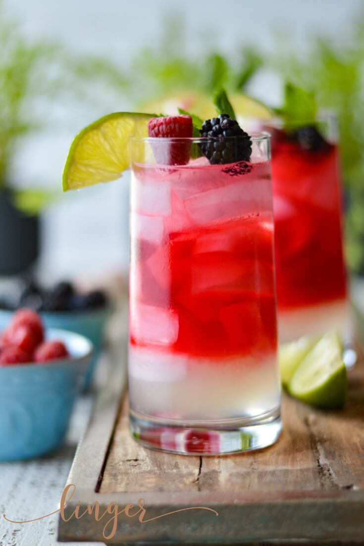 How to make a classic mojito cocktail with berry-infused rum. This recipe calls for fresh lime juice, blackberries, raspberries and of course your favorite white rum alcohol. #berryinfusedliquor #rum #mojito #berryinfusedmojito #fruitinfusedliquor #raspberries #blackberries #whiterum #cocktails