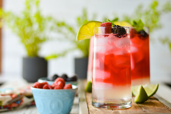 Easy Dinner Party Recipes That Will Impress your Friends - Glasses of Berry Infused White Rum Mojito