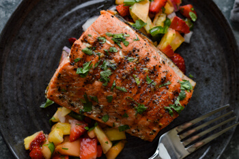Easy Dinner Party Recipes That Will Impress your Friends - Pan Seared Sockeye Salmon with Fruit Salsa - Plated cooked sockeye salmon on a bed of fresh fruit salsa