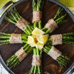 Prosciutto Wrapped Roasted Asparagus Bundles in pinwheel shape