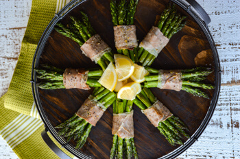 Easy Dinner Party Recipes That Will Impress your Friends - Prosciutto Wrapped Roasted Asparagus Bundles in pinwheel shape