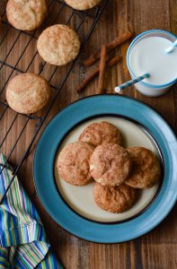 Soft and Chewy Fluffy Snickerdoodle Cookies - sitting on a blue plate with a glass of milk
