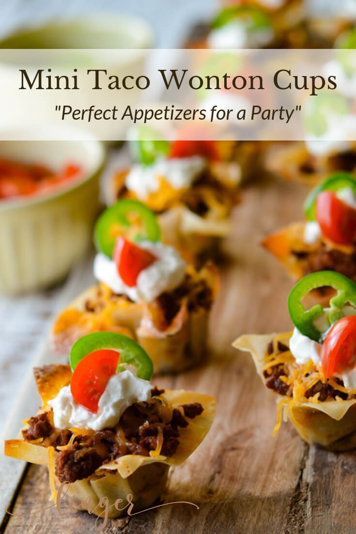 These Mini Taco Wonton Cup Appetizers are the perfect recipe for game day or tailgating. A quick and easy throw together with layers of refried beans, chorizo and shredded cheese. #tacos #minitacos #wontons #appetizers #tailgating #gamedayrecipes