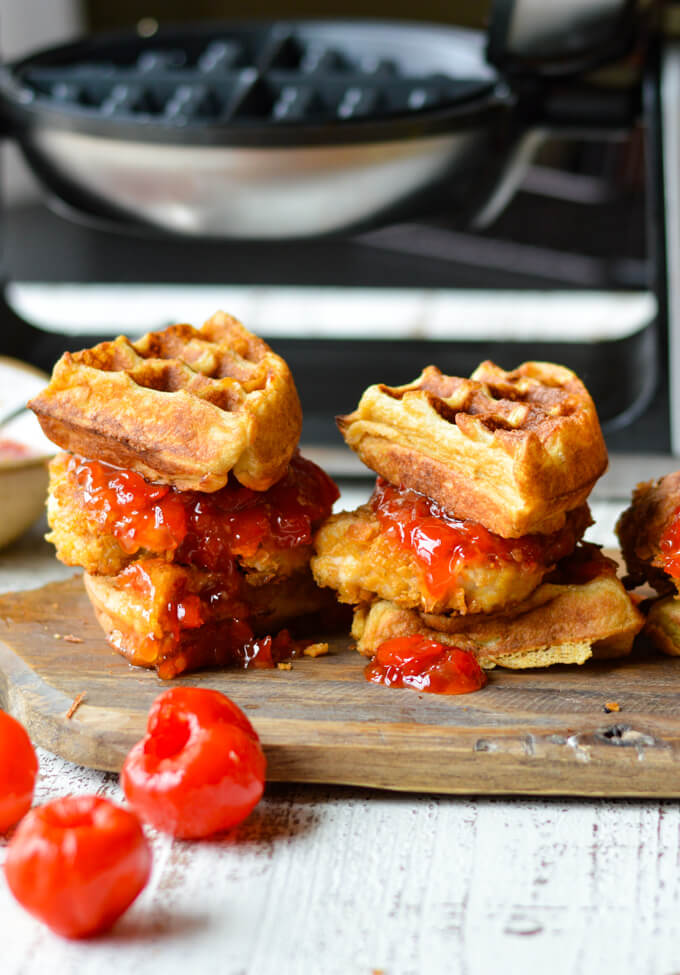 Chicken and Waffles with Sweet-Spicy Peppadew Jam with waffle iron in the background