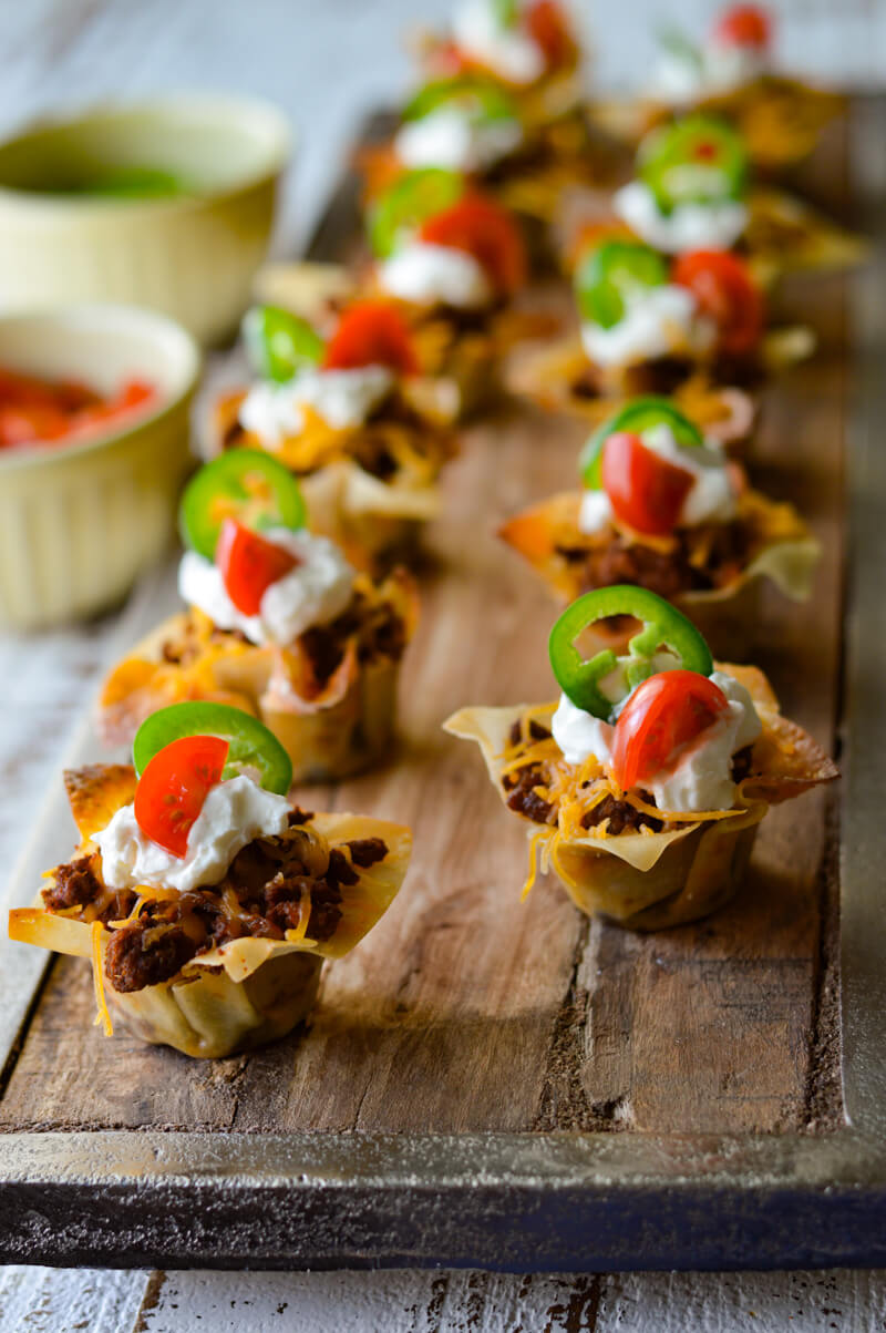 Mini Taco Wonton Cup Appetizers, on a wooden tray