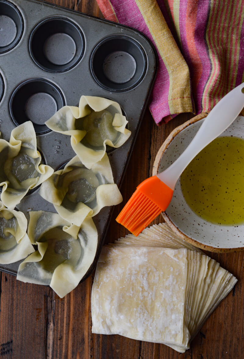 Mini Taco Wonton Cup Appetizers, wontons in mini muffin tin with olive oil and brush