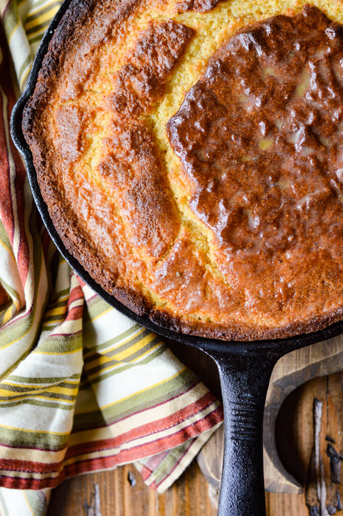 Golden brown cornbread in a cast iron pan