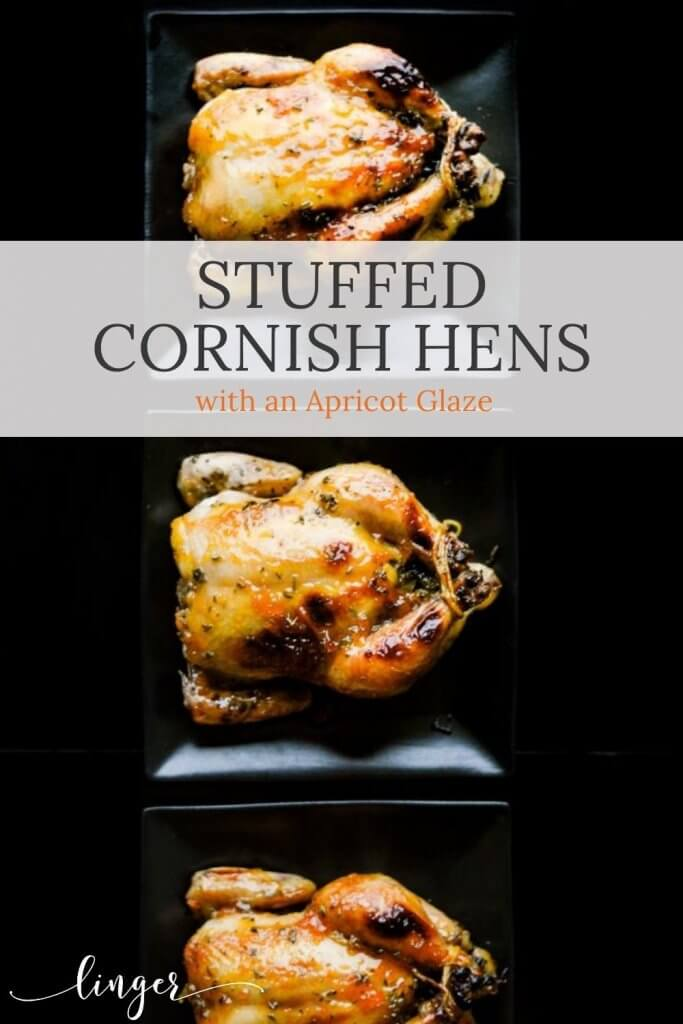 Stuffed cornish hens with dried apricots and garnished with fresh sage