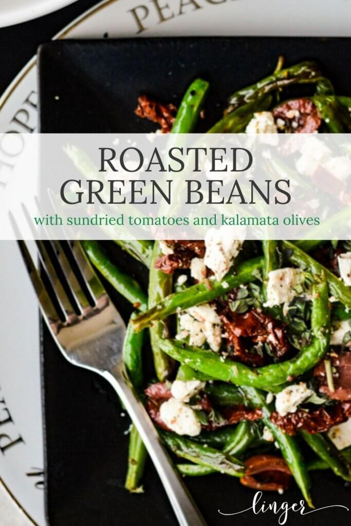 Roasted green beans with sundried tomatoes, kalamata olives and feta cheese on a black plate and a holiday white plate.