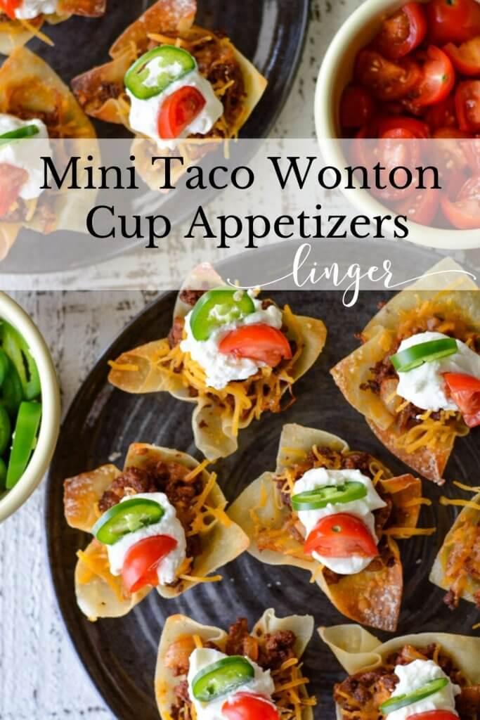 Mini Taco Wonton Cups with sour cream, cherry tomato and jalapeno slices.