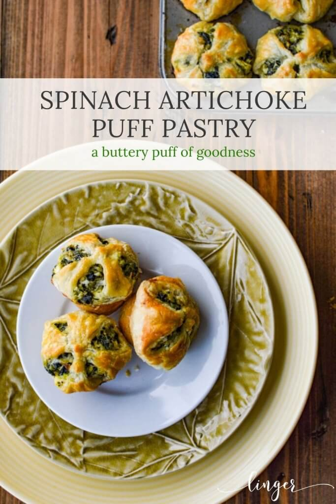 Three Spinach and Feta Puff Pastry Appetizers sitting on several stacked plates.