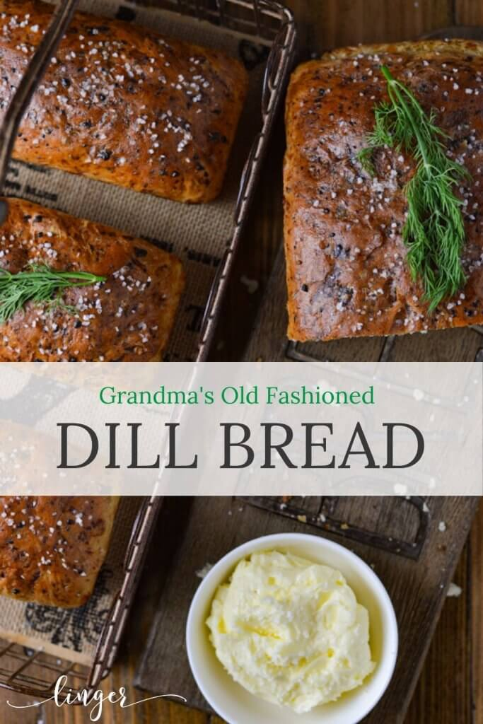 Three mini dill loafs of dill bread sit in a wire basket next to a half loaf on a wooden cutting board and a bowl of whipped butter.