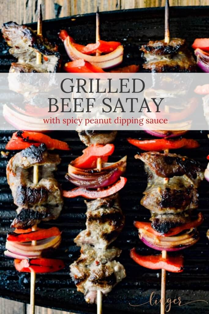 Beef Satay - Flank steak, red onions, red bell peppers on wooden skewers are on an Electric Grill.