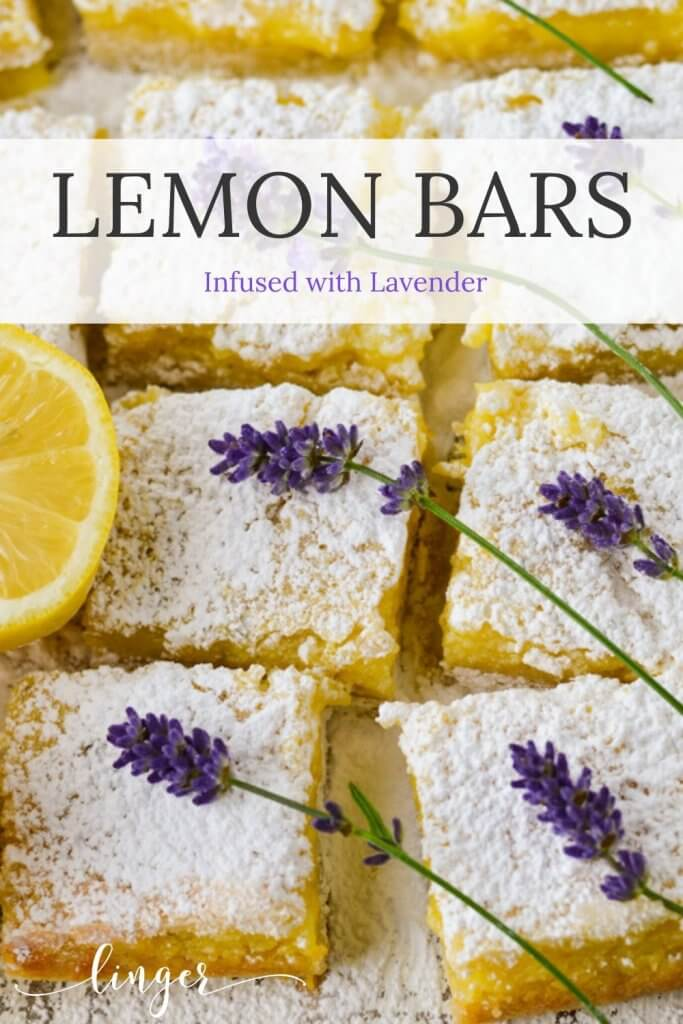 Two rows of lavender infused lemon bars with powdered sugar and lavender flowers.