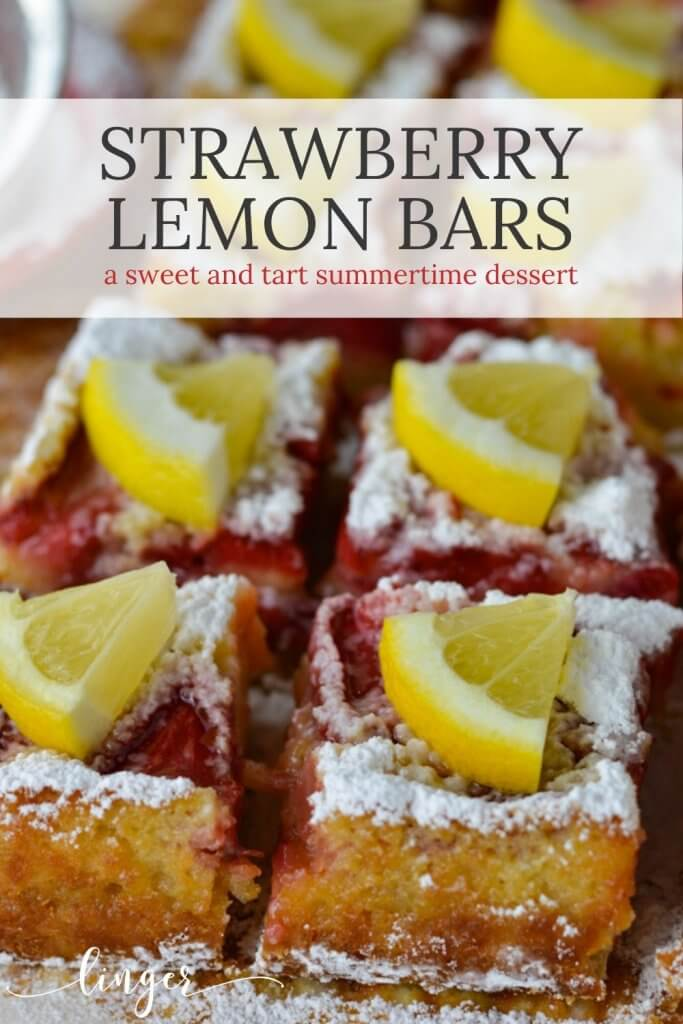 Two rows of strawberry lemon bars sprinkled with powdered sugar and topped with a wedge of fresh lemon. A red bowl with powdered sugar and a sifter sits in the background.