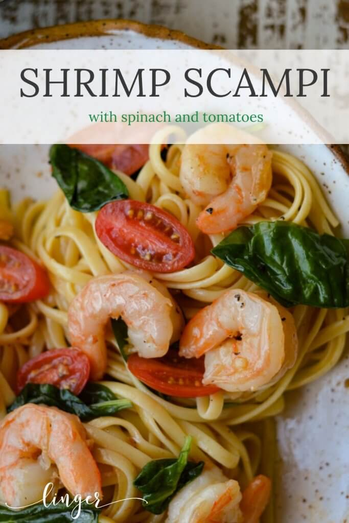 Shrimp Scampi with tomatoes and spinach in a white bowl.