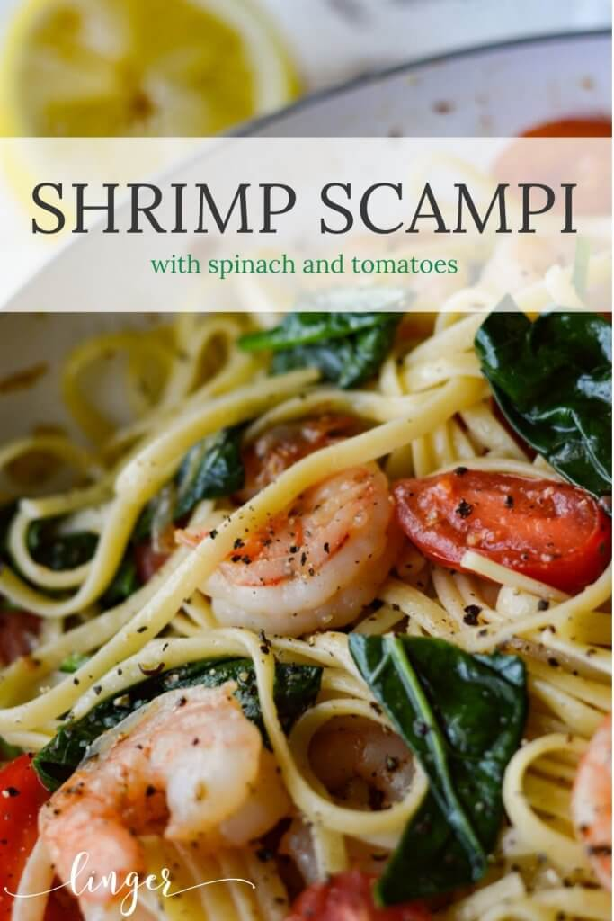 A skillet of shrimp scampi with tomatoes and spinach.
