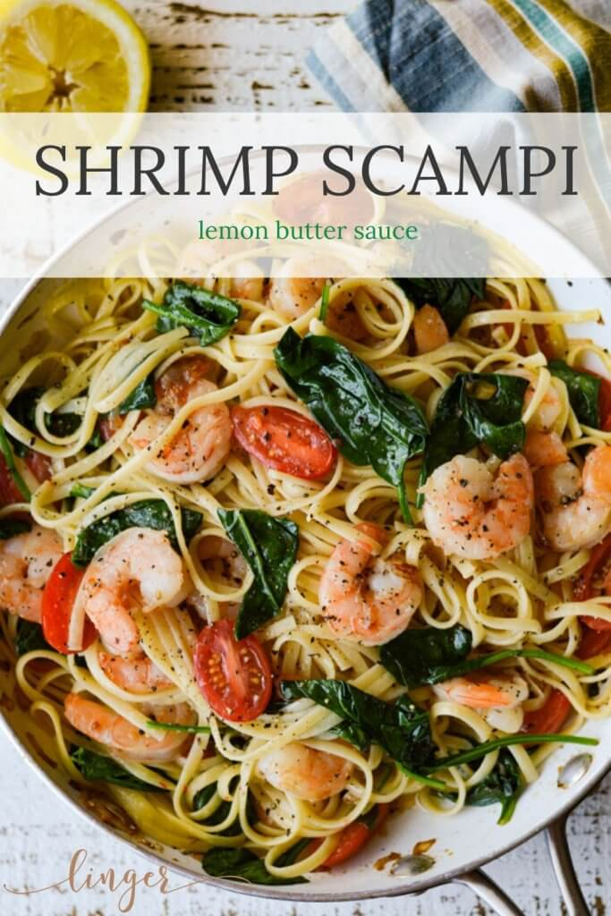 Shrimp Scampi Pasta with Spinach and Cherry Tomatoes in a skillet