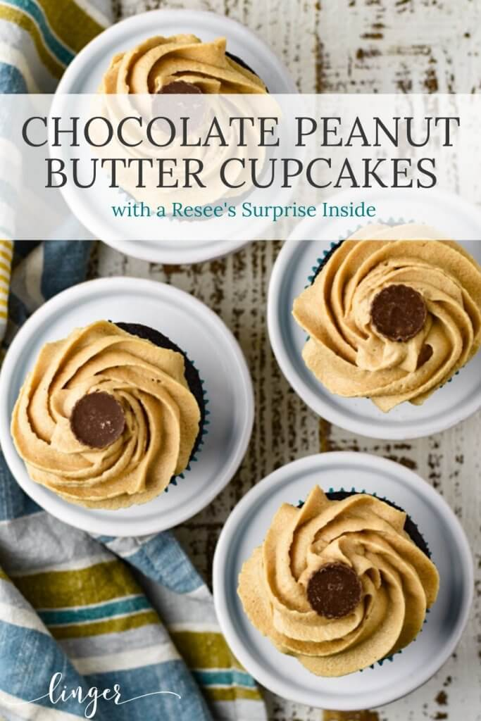 Four chocolate peanut butter cupcakes sit on four mini cake platters with a blue and yellow striped napkin beside them.