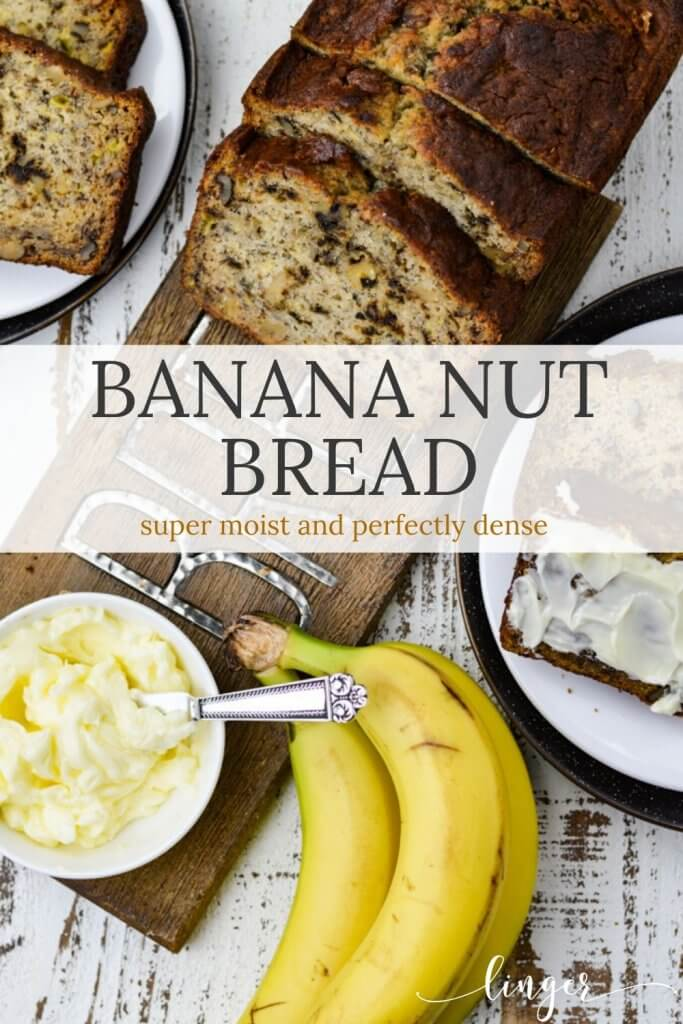 Slices of banana nut bread sit on a wooden cutting board with a small bowl of butter. Two slices of bread, one buttered and three bananas sit next to it.