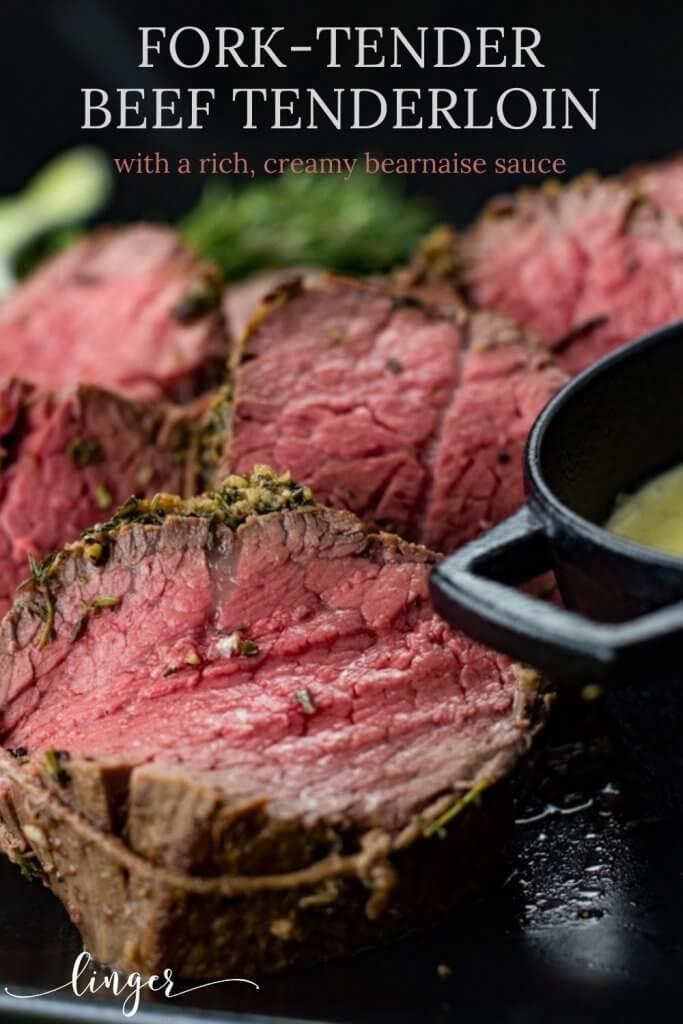 Slices of rare beef tenderloin next to a black bowl of homemade bearnaise sauce.