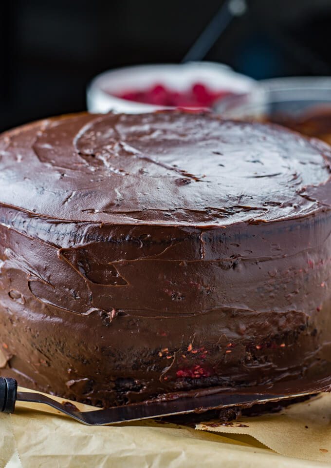 A four layer chocolate cake frosted with a crumb layer.