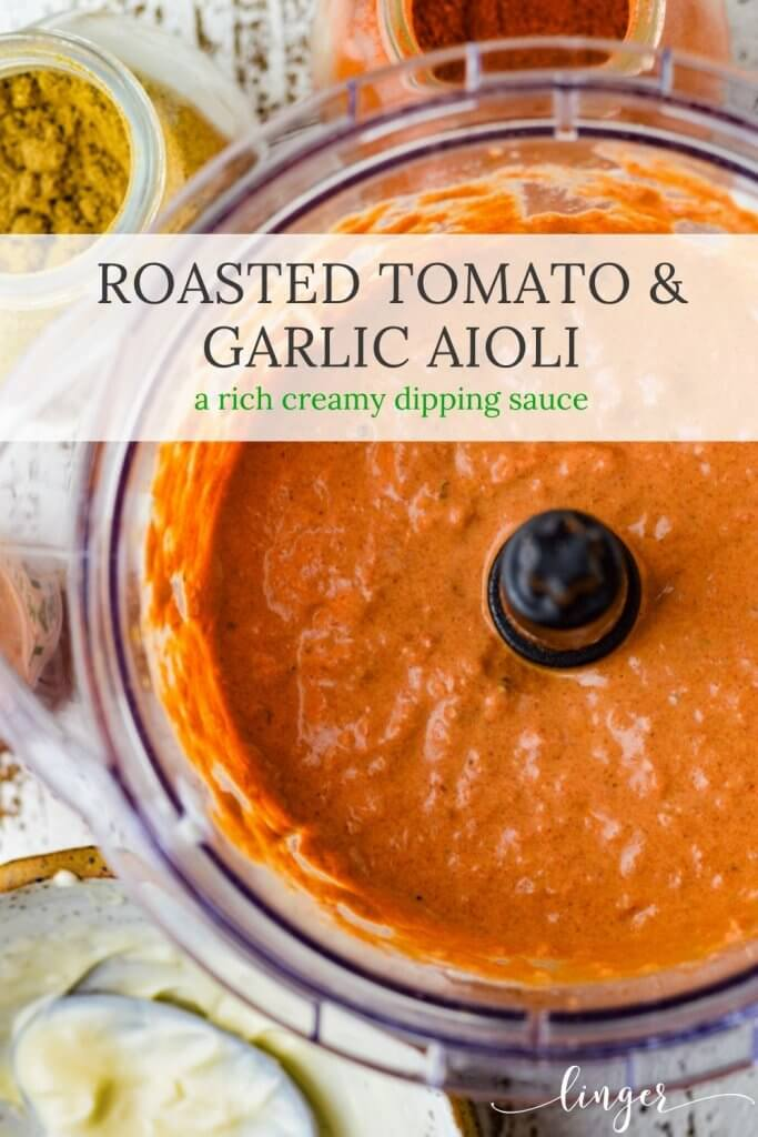 Spicy Roasted Tomato and Garlic Aioli is blended in a food processor. Bowls of mayonnaise, cumin and smoked paprika sit next to the food processor.